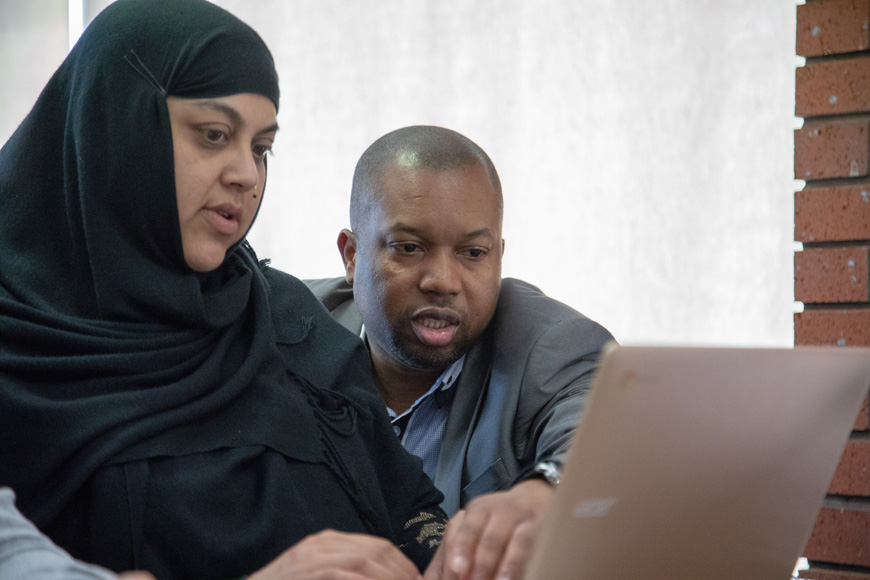 Birmingham student with lecturer on laptop