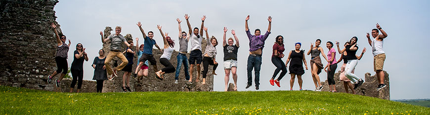 International Students Jumping in the air