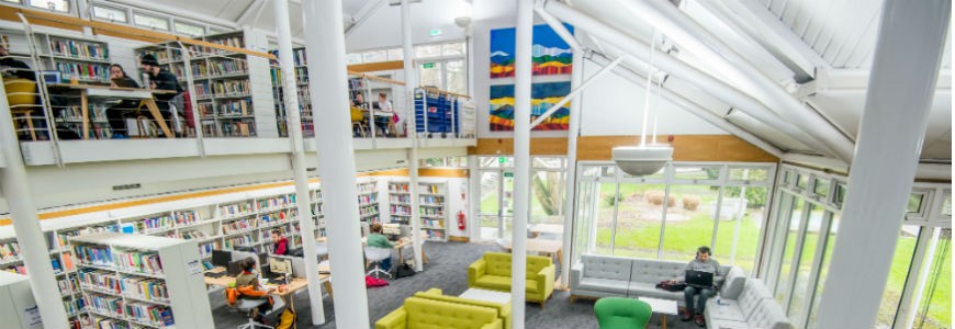 Books, sofas, tables and chairs in the UWTSD Carmarthen Library