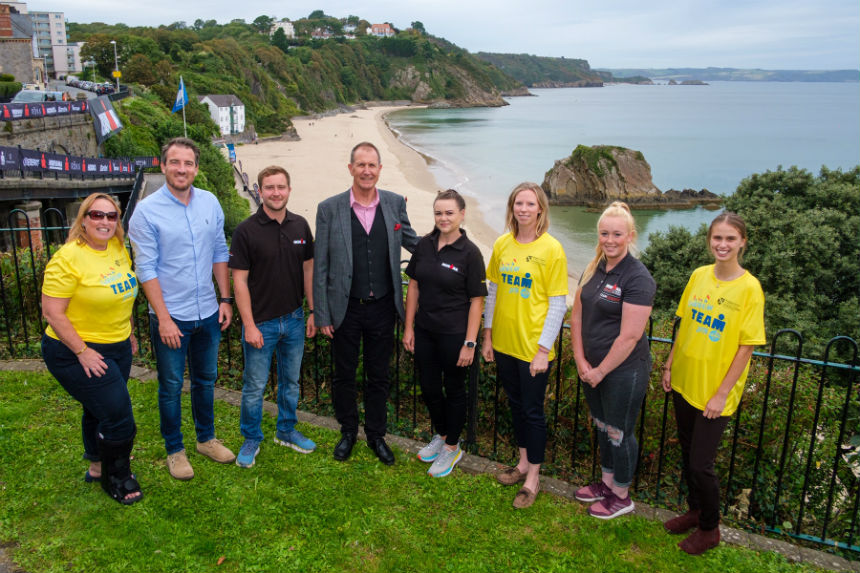 UWTSD and Ironman staff gather in Tenby to launch new partnership