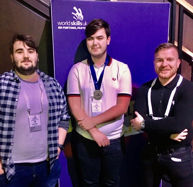 Zack Evans, who won a silver medal at WorldSkills in Birmingham, with Andrew and Gwyn